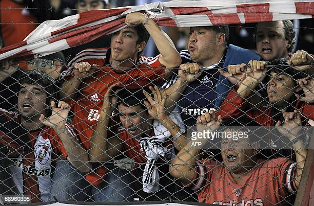 Supporters of River Plate hurl insults and boo at the players and team's coach after their Argentina first division football match against Lanus at...