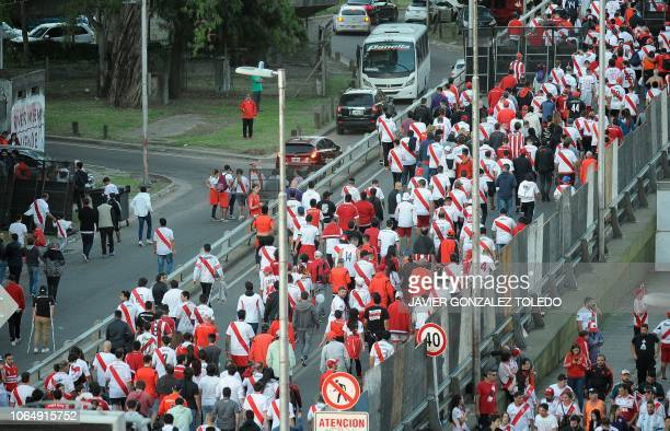 Supporters of River Plate leave the Monumental stadium in Buenos Aires after authorities postponed the all-Argentine Copa Libertadores second leg...