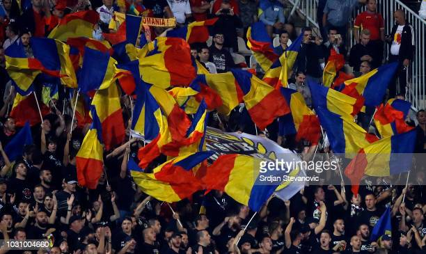 Supporters of Romania cheer for their team during the UEFA Nations League C group four match between Serbia and Romania at stadium Partizan on...