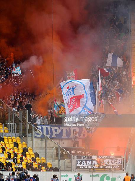Supporters of Rostock are pictured during the Second Bundesliga match between SG Dynamo Dresden and FC Hansa Rostock at Gluecksgas-Stadion on July...