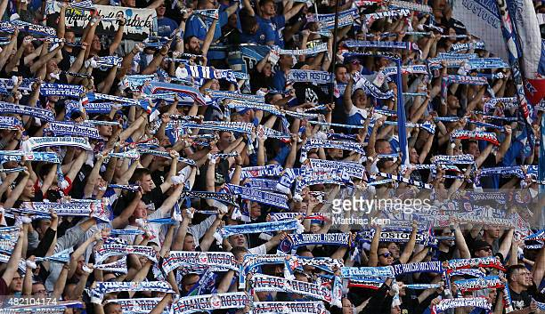 Supporters of Rostock celebrate their team during the third league match between FC Hansa Rostock and SV Werder Bremen II at Ostseestadion on July 25...
