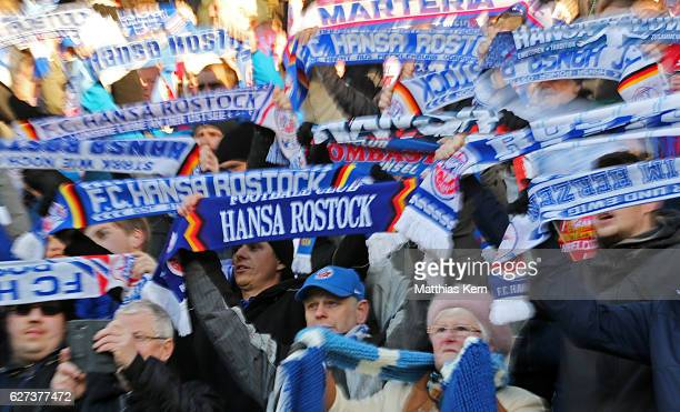 Supporters of Rostock celebrate their team during the third league match between FC Hansa Rostock and Holstein Kiel at Ostseestadion on December 3...