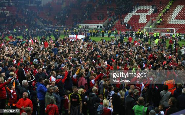 Supporters of Rotherham United invade the pitch after the Sky Bet League One Play Off Semi Final second leg match between Rotherham United and...