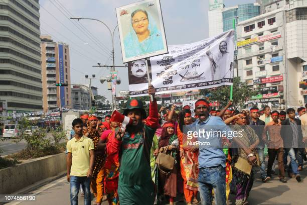 Supporters of ruling Bangladesh Awami League take part in an election campaign rally ahead of general election in Dhaka on December 21 2018 More than...