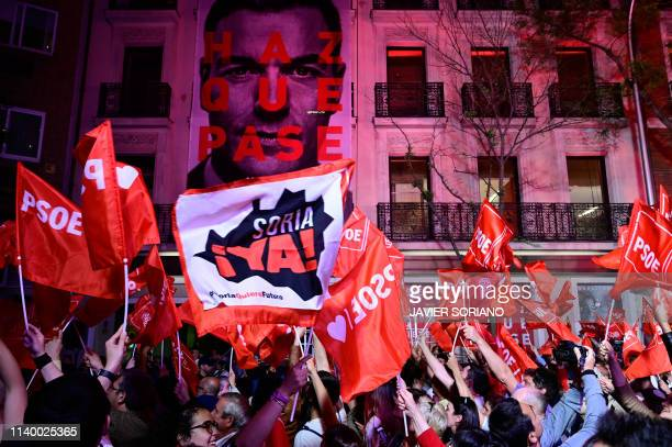 TOPSHOT Supporters of ruling Spanish Socialist Party celebrate in front of the party headquarters in Madrid after Spain held general elections on...