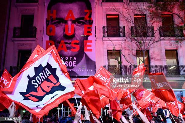 Supporters of ruling Spanish Socialist Party celebrate in front of the party headquarters in Madrid after Spain held general elections on April 28...