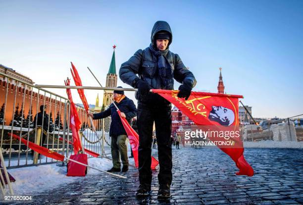 Supporters of Russian Communist parties and movements hold flags bearing the portrait of Soviet leader Joseph Stalin's as they attend a memorial...