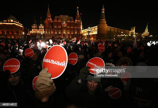 Supporters of Russian opposition leader and anti-corruption blogger Alexei Navalny hold an unsanctioned rally at Manezhnaya Square on December 30,...