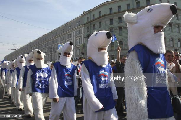 Supporters of Russia's dominant pro-Kremlin United Russia party dressed as polar bears during a traditional Mayday parade in St. Petersburg on May 1,...
