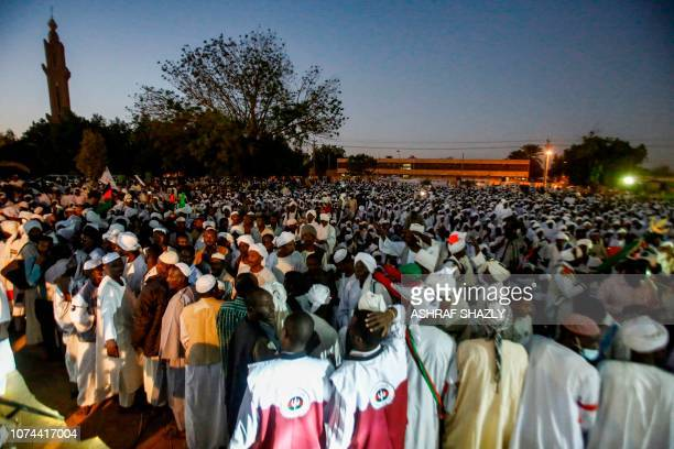 Supporters of Sadiq alMahdi Sudan's exprime minister and leader of the opposition Umma Party gather as he addresses them in a mosque in the capital...