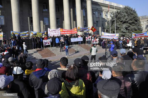 Supporters of Sadyr Japarov celebrate following the approval of Sadyr Japarov as the new prime minister by the Kyrgyz parliament, outside of the...