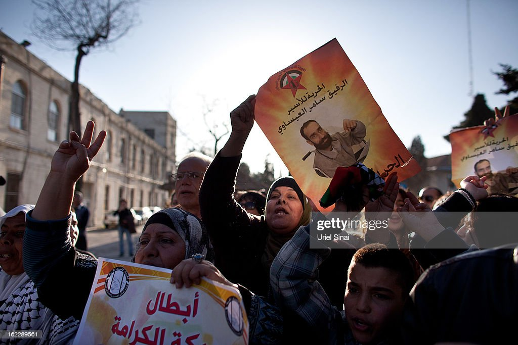 Supporters of Samer al-Issawi, a Palestinian prisoner on a hunger strike, demonstrate outside the Magistrate's Court on February 21, 2013 in Jerusalem, Israel. Issawi, one of the prisoners who was released under terms of the 2011 Gilad Shalit prisoner swap, was rearrested last July on charges of violating the terms of his release when he took his car to a garage in the West Bank.