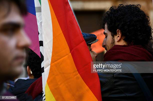 Supporters of samesex civil unions demonstrate at the Piazza delle Cinque Lune in Rome on February 24 2016 Prime Minister Matteo Renzi is bowing to...