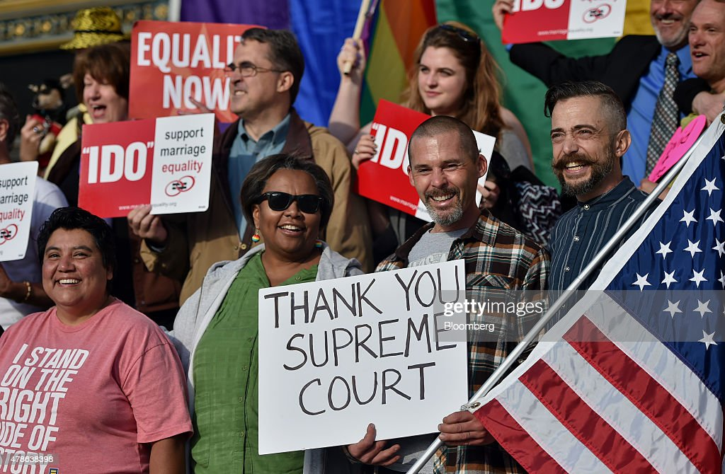 Supporters of same-sex marriage celebrate outside of City Hall after the U.S. Supreme Court ruling in San Francisco, California, U.S., on Friday, June 26, 2015. Same-sex couples have a constitutional right to marry nationwide, the U.S. Supreme Court said in a historic ruling that caps the biggest civil rights transformation in a half-century. Photographer: Josh Edelson/Bloomberg via Getty Images