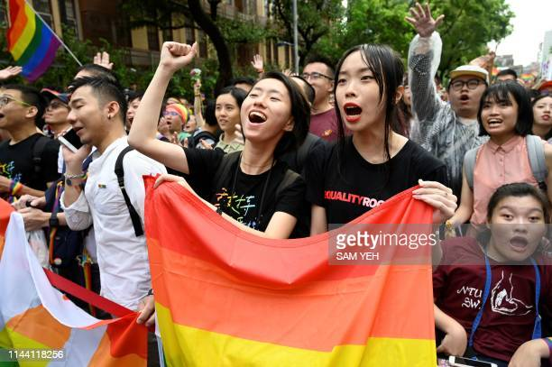 Supporters of same-sex marriage celebrate outside the parliament in Taipei on May 17, 2019. - Taiwan's parliament legalised same-sex marriage on May...