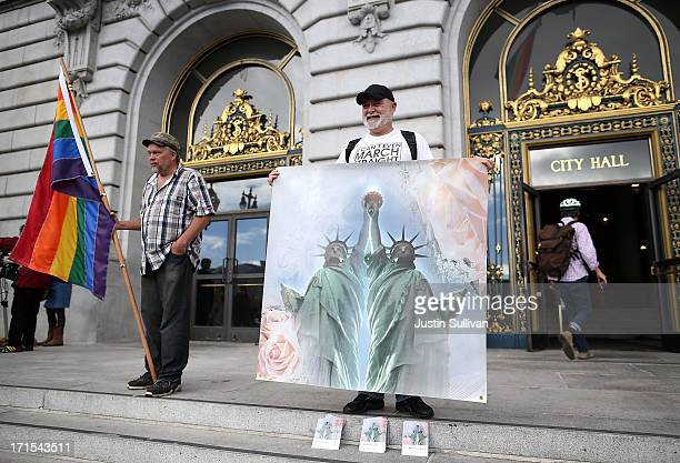 Supporters of samesex marriage stand in front of San Francisco City Hall after the announcement of the results of the US Supreme Court's rulings on...