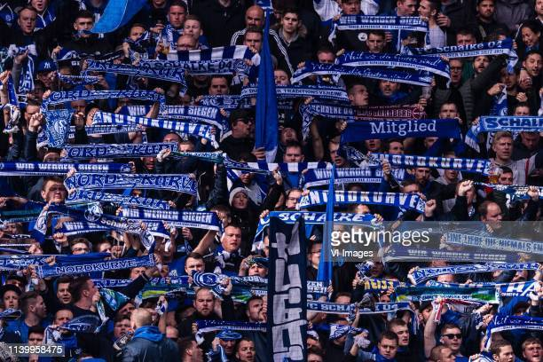 supporters of Schalke 04 DFL regulations prohibit any use of photographs as image sequences and/or quasivideo during the Bundesliga match between...