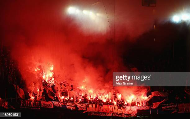 Supporters of Schalke burn flares prior to the UEFA Champions League Group E match between FC Basel 1893 and FC Schalke 04 at St JakobPark on October...