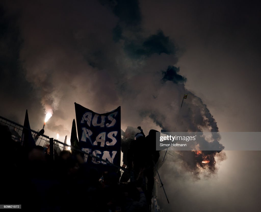 Supporters of Schalke light fireworks during the Bundesliga match between 1. FSV Mainz 05 and FC Schalke 04 at Opel Arena on March 9, 2018 in Mainz, Germany.