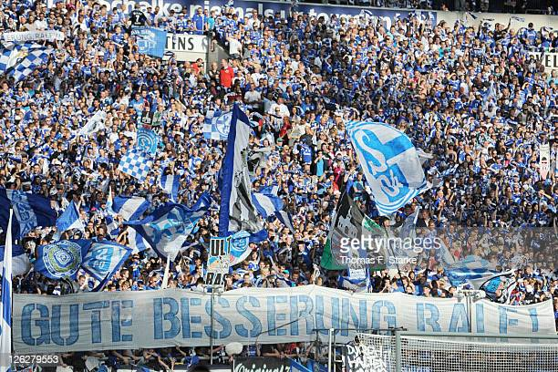 Supporters of Schalke show a banner for their coach Ralf Rangnick who retired this week because of a burn out syndrom prior to the Bundesliga match...