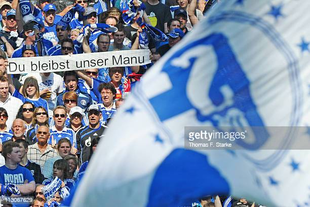 Supporters of Schalke show banners for goalkeeper Manuel Neuer who announced leaving the club at the end of this season during the Bundesliga match...