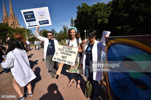 Supporters of science and research prepare to hand out leaflets as part of the March for Science protest in Sydney on April 22 2017 Thousands of...