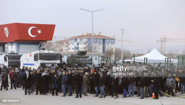 Supporters of Selahattin Demirtas the jailed leader of the Peoples' Democratic Party wait in front of a court house during his trial in Ankara on...
