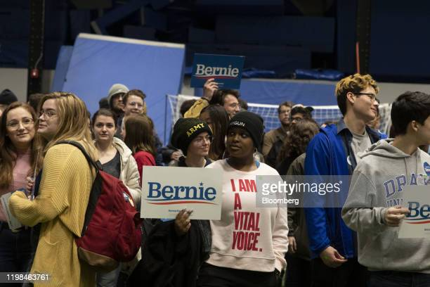 Supporters of Senator Bernie Sanders an Independent from Vermont and 2020 presidential candidate stand together during the firstinthenation Iowa...