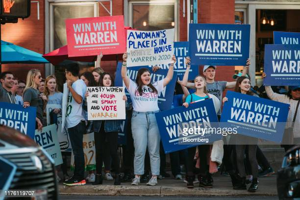 Supporters of Senator Elizabeth Warren, a Democrat from Massachusetts and 2020 presidential candidate, hold signs and chant ahead of the Democratic...
