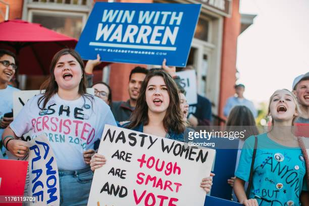 Supporters of Senator Elizabeth Warren a Democrat from Massachusetts and 2020 presidential candidate hold signs ahead of the Democratic presidential...