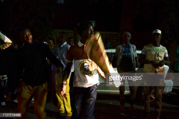 Supporters of Senegalese President Macky Sal celebrate February 25 2019 in Dakar Senegal's Macky Sall was reelected with 'at least 57 percent' of the...