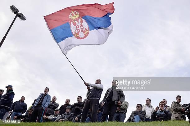 Supporters of Serbian nationalist Vojislav Seselj wait for his arrival at Belgrade airport on November 12 2014 Ailing Serb leader Seselj who has been...