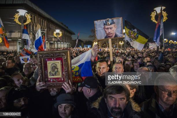 TOPSHOT Supporters of Serbian President and Russian President Vladimir Putin wait for their arrival in front of Belgrade's Saint Sava Church on...