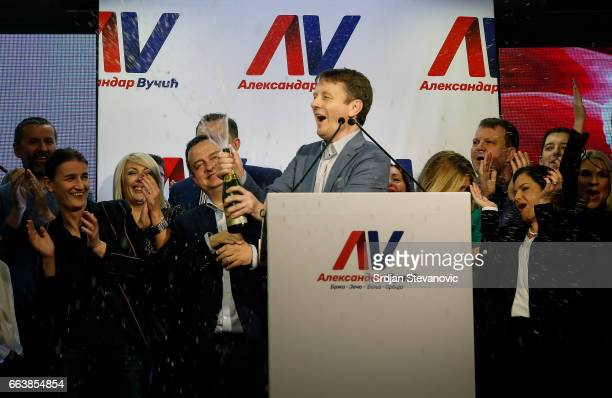 Supporters of Serbian Prime Minister and presidential candidate Aleksandar Vucic celebrate his win in presidential election at his headquarters on...