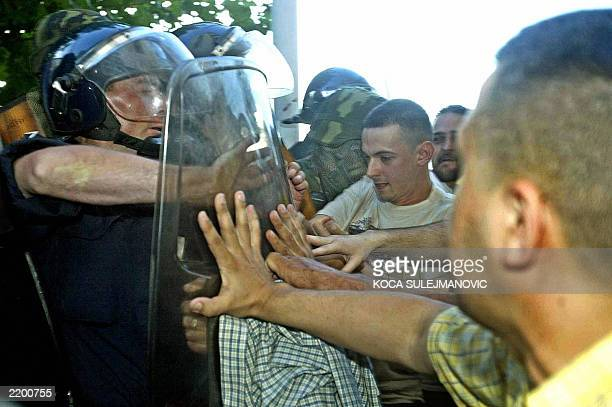 Supporters of Serbian war crimes suspect Veselin Sljivancanin scuffle with police cordoning off the former Yugoslav army colonel's house in Belgrade...