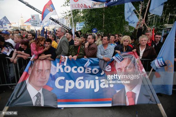 Supporters of Serbia's nationalist prime minister and leader of the Democratic Party of Serbia DSS Vojislav Kostunica stand in front of a banner...