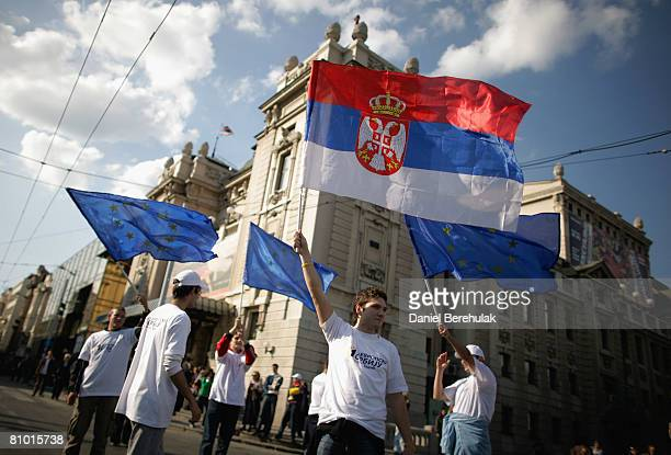 A supporters of Serbia's proWestern president and Democratic Party leader Boris Tadic wave Serbian and EU flags during a preelection rally on May 7...