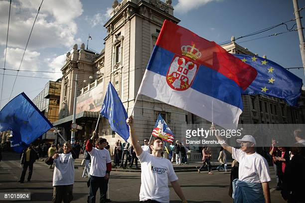 Supporters of Serbia's proWestern president and Democratic Party leader Boris Tadic wave Serbian and EU flags during a preelection rally on May 7...