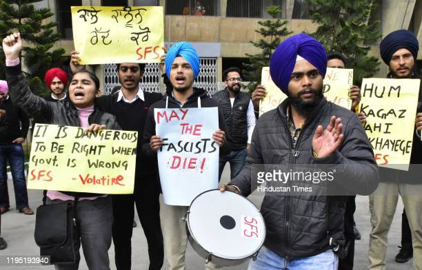 Supporters of SFS from Guru Nanak Dev University hold placards during a protest against Citizen Amendment Act , at GNDU campus on January 21, 2020 in...