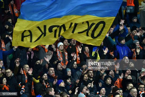 Supporters of Shakhtar Donetsk react during the UEFA Champions League Groupe F football match FC Shakhtar Donetsk and Olympique Lyonnais on NSK...