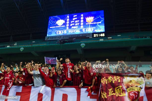Supporters of Shanghai SIPG celebrate after the AFC Champions League Round of 16 2nd Leg match between Jeonbuk Hyundai Motors and Shanghai SIPG at...
