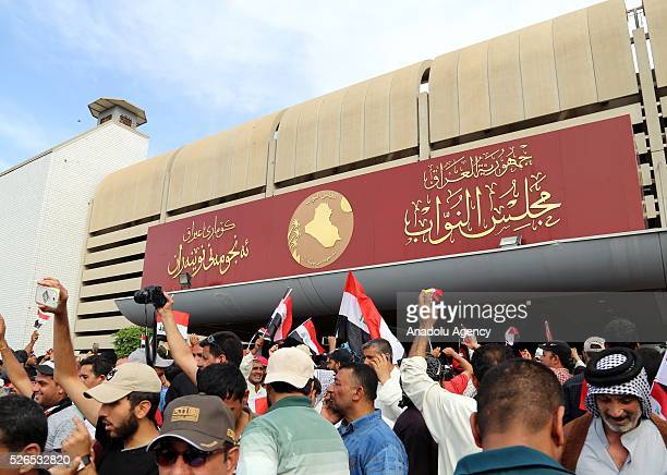 Supporters of Shiite cleric Muqtada alSadr storm parliament in Baghdad's Green Zone on April 30 2016 Thousands of protesters carrying Iraqi flags and...