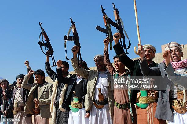TOPSHOT Supporters of Shiite Huthi rebels and militiamen shout slogans raising their weapons during a rally against the Saudiled coalition which has...
