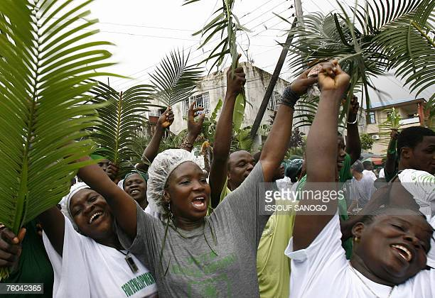 Supporters of Sierra Leone's current vice president Solomon Berewa shout slogans during an election campaign rally in Freetown 09 August 2007 Despite...