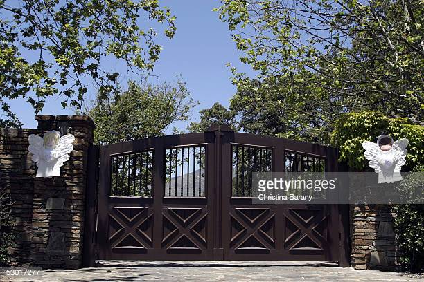 Supporters of singer Michael Jackson have placed two angels on the gate at the entrance to his Neverland Ranch June 3 2005 in Los Olivos California...