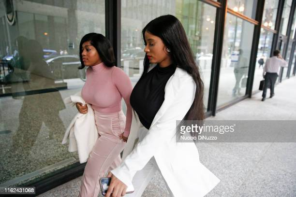 Supporters of singer R. Kelly, and Joycelyn Savage and Azriel Clary arrive for the singer's arraignment at the Dirksen Federal Building on July 16,...
