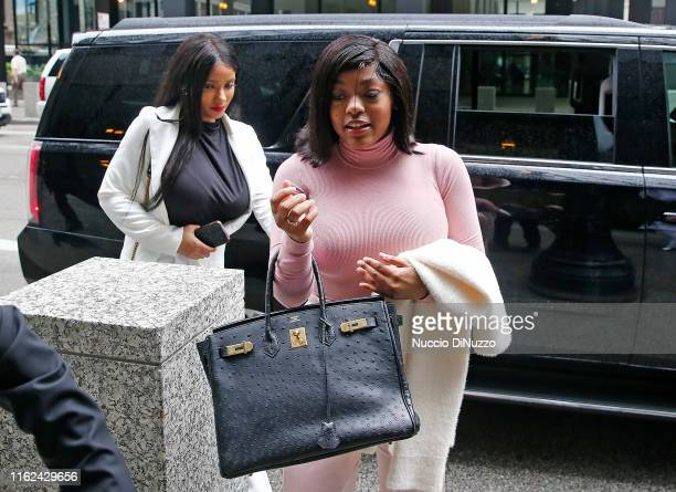 Supporters of singer R. Kelly, Azriel Clary, and Joycelyn Savage, arrive the singer's arraignment at the Dirksen Federal Building on July 16, 2019 in...