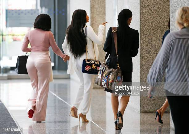 Supporters of singer R. Kelly, Azriel Clary and Joycelyn Savage, arrive with their attorneys, for the singer's arraignment at the Dirksen Federal...