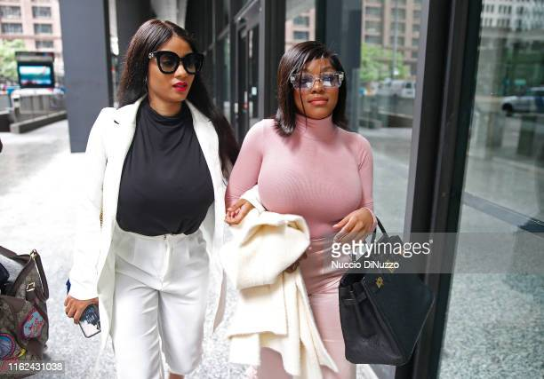 Supporters of singer R. Kelly, Azriel Clary and Joycelyn Savage leave after the singer's arraignment at the Dirksen Federal Building on July 16, 2019...