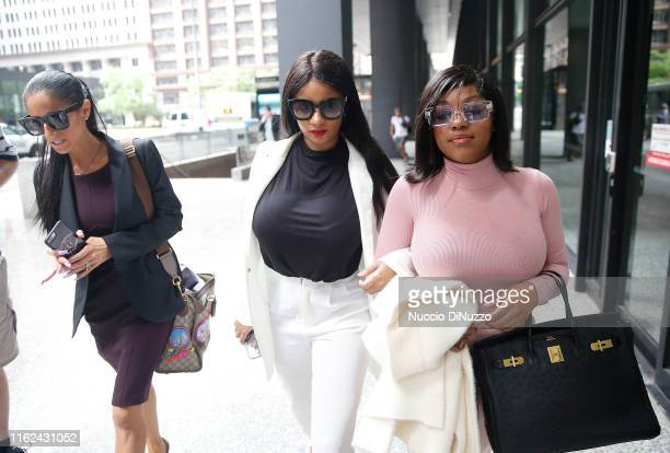 Supporters of singer R. Kelly, Azriel Clary and Joycelyn Savage, leave after the singer's arraignment at the Dirksen Federal Building on July 16,...